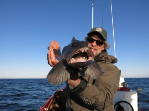 Jay Nicholas with Pacific lingcod offshore Pacific City Oregon.
