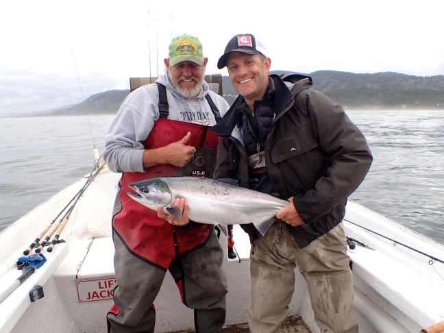 Capt John Harrell and Rob Perkin with nice silver salmon.